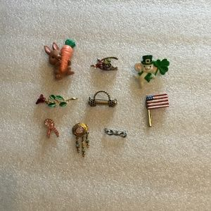 Collection of 9 colorful brooches or pins